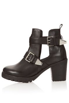 ANCHOR Cut Out Buckle Boots-- @ Topshop.  I need a replacement for the black boots with a chunky heel Ive been wearing for maybe 10 years lol-- These are modern, love the silver buckle details.  Cut out design allow for contrast with stockings or chunky socks.....
