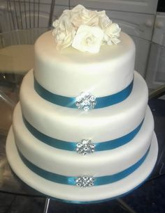 3 Tier Wedding Cake with Teal Decoration. For you Ashley!!! It matches the color on your dress.