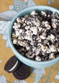 Cookies and Cream Popcorn 1 bag kettle corn or regular white popcorn 12 Oreos, crushed finely 6 oz vanilla candy melts