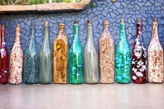 old wine bottles = outdoor decoration! Oh, so this is why I've been saving ALL these wine bottles. Old Wine Bottles, Wine Bottle Corks, Painted Wine Bottles, Wine Bottle Crafts, Bottles And Jars, Cut Bottles, Glass Bottles, Cork Crafts, Diy Crafts