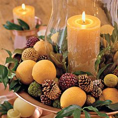 Christmas Centerpieces - pine cones are in my backyard, saw these lemons at Dollar Tree the other day, have a hurricane lamp in the closet, just need a gold/bronze plate!
