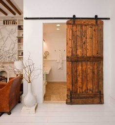 Sliding Barn Interior Doors....bringing the outhouse in... this would never work at my house but i LOVE the concept...