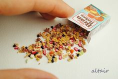 Here it offers on 1 beautiful, super realistic-looking box of cereal with Granola. The crunchy cereal with banana, strawberry and fruit slices was formed from polymer clay.  Box large: 3, 3cm x 2, 3cm  This miniature food replicas are perfect for a dolls House.  fits any Monster high dolls, Barbie, Doll House and co  Please check the measurements of miniatures be sure that the size fits your needs. All polymer clay articles are individually shaped and detailed. Small variations are to be…