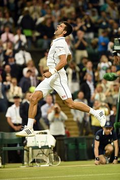 Wimbledon 2014: Novak Djokovic leaps into the air following his victory on Centre Court - Jon Buckle/AELTC