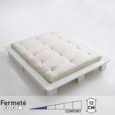Invitez le Japon dans votre chambre ! Ce matelas futon fabriqué à la main de façon traditionnelle offre un couchage sain au confort ferme.CONFORT FUTON :- Le capitonnage par boutons noirs assure un maintien efficace du garnissage pour une meilleure qualité de couchage et de confort.- 7 couches de pur coton de très belle qualité.- Confort très ferme à la japonaise.- Hauteur : 12 cm.COUTIL :- Bachette 100% coton (230gr/m²).- Traitement antitaches TEFLON.