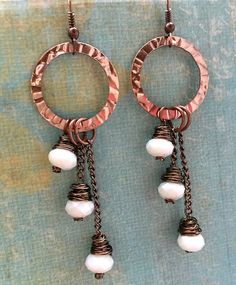 These gorgeous handmade wire wrapped milky white crystal beads and copper long dangle earrings are a must have for the stylish woman! Lots of shimmer and movement with these earrings.