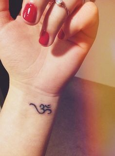 65 Modern Om Tattoo Designs and Ideas for Men and Women . - 65 modern om tattoo designs and ideas for men and women - Om Wrist Tattoo, Simbols Tattoo, Om Symbol Tattoo, Piercing Tattoo, Ohm Symbol, Om Tattoo Design, Tattoo Designs Wrist, Small Tattoo Designs, Mini Tattoos