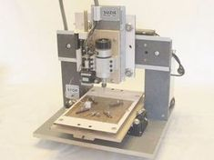 A homemade CNC machine for cutting PCBs. By Rui Fernando Caldas.