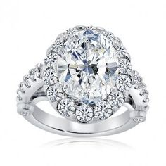 Halo Set Oval Engagment Ring With Claw Set Side Stones miiine