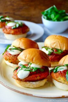 Swap the forks in favor of your fingers with this recipe for easy chicken Parmesan sliders topped with mozzarella, marinara and fresh basil.