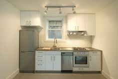 rental kitchen. That's an LG refrigerator, 18-inch dishwasher. Ikea cabinets, sink, cooktop, wall oven and hood. Photo: Mitchell Snyder Phot...