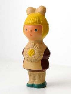Russian vintage rubber squeaking toy. Circa 1950s. It presents a little schoolgirl in a traditional uniform.