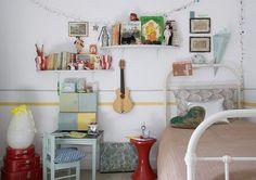 Exchange the lights for garland,     http://manolohome.com/wordpress/wp-content/uploads/2010/10/eclectic-kids-rooms-vintage.jpg