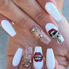 Nudes embellished with Red Lips. The love for glitter and music can be seen best in this amazingly craeted coffin nail art design.