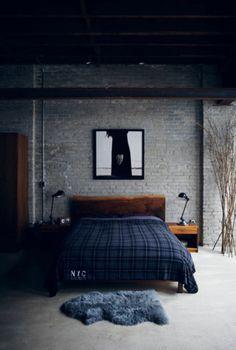 Plaid bed and brick walls...perfect.
