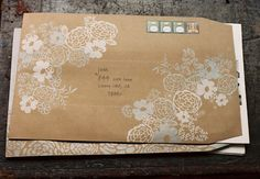brown envelope with white drawing