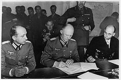 Gen. Alfred Jodl, Oberkommando der Wehrmacht (OKW or Chief of the High Command of the German Armed Forces), signing the instrument of unconditional surrender by Germany, ending the war in Europe. He signed in the early hours of May 7, 1945, effective in the evening of May 8, the day recognized as V-E Day. Jodl was hanged after a trial in Nuremburg for signing the notorious Commando and Commissar Orders, calling for the summary executions of all commando prisoners and Russian political…