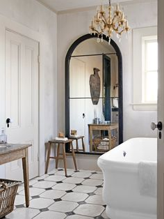 With the addition of custom-cut mirrors, a cast-off window frame becomes and impressive full-length looking glass. #bathroomdecor