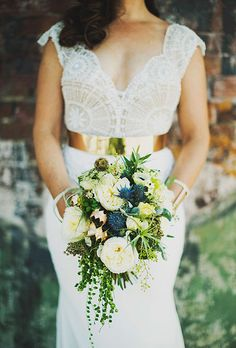 Natural Wedding Bouquets: White, Green, and Blue Roses, Anemones, Air Plants, Greenery, and Thistle | Brides.com