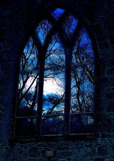 Dark night looking through the Gothic window.