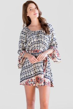 """We love the boho feel of the Maili Floral Dress. A bold navy & whiteprint is featured on this casual shift dress trimmed with a pink floral print. Finished with a tie around the waist.<br /> <br /> - 32"""" length from shoulder to hem<br /> - 42"""" chest<br /> - 72"""" sweep<br /> - measured from a size small<br /> <br /> - 100% Viscose<br /> - Hand Wash<br /> - Imported"""