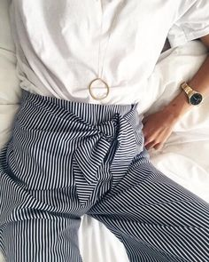 white shirt, black and white striped trousers