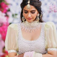 Sonam Kapoor has always been a trendsetter and this time it's no different! Her dupatta necklace in Veere di Wedding is making waves in the wedding industry. Lengha Blouse Designs, New Blouse Designs, Asian Prom Dress, Veere Di Wedding, Flower Girl Hairstyles, Wedding Hairstyles, Indian Bridal Fashion, Bollywood Fashion, Bollywood Saree