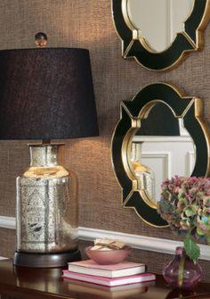 those mirrors. Seagrass walls. Mercury glass lamp.