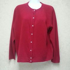 Designers Original cardigan sweater Classic cardigan in a deep red (darker than my pics). Nice knit detail around collar and front.  Buttons look like pearl buttons.  100% acrylic.  Gently used. Designers Originals Sweaters Cardigans