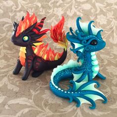Fire and water elements! Oh man was that fire tricky. He even has slightly singed paws and horn tips. I love the water dragons colors so… Polymer Clay Dragon, Polymer Clay Figures, Polymer Clay Sculptures, Cute Polymer Clay, Polymer Clay Animals, Cute Clay, Polymer Clay Charms, Polymer Clay Projects, Polymer Clay Creations