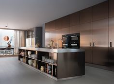 Italia island and storage units with PVD bronze (Physical Vapour Deposition) stainless steel doors. 12 cm thick steel worktop with Hide hood for top in..