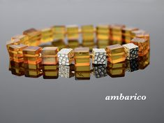 """Elegant bracelet of authentic Baltic amber with impurities of herbs and earth """"Datiles"""". Elastic bracelet, without clasp. Each product a gift linen bag. Beads among amber is sterling silver, transparent amber. Coral Stone, Amber Bracelet, Linen Bag, Baltic Amber, Gem S, Bangles, Bracelets, Sterling Silver, Pendant"""