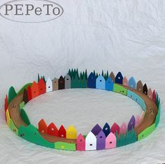 A simple but effective idea Ikea wooden tracks decorated with colourful foam buildings by Pepeto My Fler Find of the Day!  Why n...