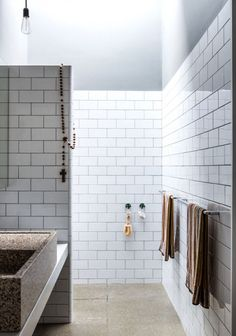 the interior collective texture subway tile bathroom  Japanese Trash masculine design inspiration