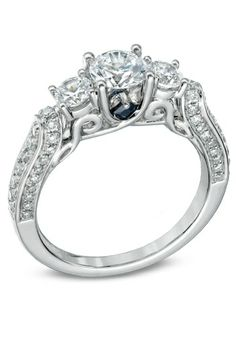 This is so amazing, and it has blue this would be my perfect right if it were in yellow gold <3