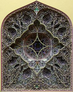 Faux Stained Glass- intricate creations that look like stained glass windows - are actually many layers of laser cut paper, by artist Eric Standley.