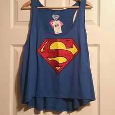 NWT SUPERGIRL XL Racerback Shirt True blue XL Racerback Shirt with glittery S on the chest, Marvel official  Smoke and pet free home  Please feel free to ask questions, or request additional photos  Don't forget to bundle for discounts! Tops Muscle Tees