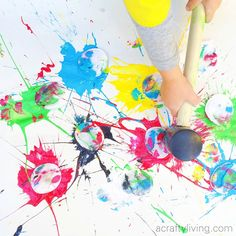 Just try and resist doing our Cotton Round Splatter Painting! Gross motor Process Art that's impossible to resist!