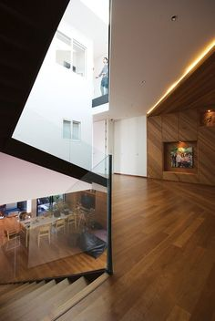 Modern minimalist house designed by Integrated Field for a family of five located in Bangkok, Thailand