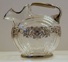 ART DECO SILVER OVERLAY PITCHER W/BEAUTIFUL OVERLAY AND ENCISED FLOWERS IN GLASS