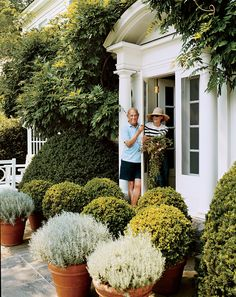 Oscar and Annette de la Renta at the door of their Connecticut country house.  Photo by Francois Halard.  Vogue, December 2008.