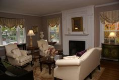 Pale mocha walls are the perfect setting for the cream seating.