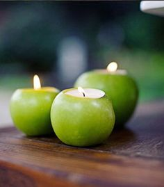 Green apples used as candle holders add aroma and warmth to any table. #Patron #Entertaining