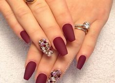 Ruby red with a crystal accent nail is elegant for any occasion.