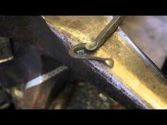 Artist blacksmith Tobbe Malm forging a bottle opener