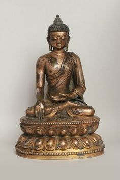 Buddha Shakyamuni. Copper alloy with remains of mercury and lacquer gilding; China, Tibeto-Chinese style, Yuan, early 14th century. Height: 23.8 cm (9.37 in) © Dr. Robert R. Bigler
