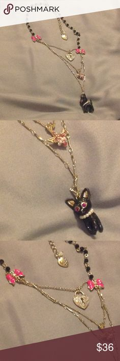 Jewelry - Necklace 🎀 BNWT Pretentious and showy Betsey Johnson Necklace featuring a cute black puppy with Ruby pink eyes & White Pearl collar.  Necklace has 3 graduating chains  - one with the black puppy - next chain with colorful bird & White Pearl collar - third chain has rainbow crystals  & the back of lock has her logo name & pink lips.  Chain is adorned with 2 pink bows & black beads. Lobster claw clasp with dangling Logo Heart charm.🎀  🎀Bundle and Save! Betsey Johnson Jewelry…