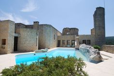 VAUCLUSE, FRANCE STATS 5 BEDROOMS 4 BATHS 6,460 SQ. FT. $5.8 MILLIONPEDIGREE: From afar, this unique hillside structure appears to be an ancient Roman ruin, with tumbling tower walls and the remains of a drawbridge and moat. Yet this former 12th-century fortress is actually an exquisitely crafted contemporary home, following a renovation by well-known French architect Roger Anger in 1995.