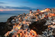 The famous Santorini sunset. Image by Hanquan Chen / Getty Images