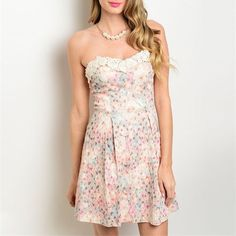 """This strapless dress features a semi-sweetheart neckline trimmed in crochet and a beautiful multicolored floral print design.    Fabric Content: 100% POLYESTER    Description: L: 28"""" B: 26"""" W: 24"""" (measurements are for model's size, size small)   Shop this product here: http://spreesy.com/TheDressChest/82   Shop all of our products at http://spreesy.com/TheDressChest      Pinterest selling powered by Spreesy.com"""